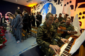 UNIFIL Spanish peacekeeper musicians accompany Marjayoun's students choir during the Christmas carols videoconference with a school in Granada (Spain). Marjayoun, South Lebanon December 21, 2015. Photo by Pasqual Gorriz (UN)