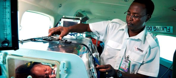 photo: Sven Torfinn Kenya, Nairobi, Januari 2007 Nurse James Mwaura, working for AMREF Flying Doctors, during a evacuation flight from Shirati in Tanzania, to Wilson Airport in Nairobi. The patient is a small baby, Lemos Dooso, born on the 13th of January 2007, in Shirati hospital, with neural problems. A charity organisation asked for the evacuation from the remote rural area of Shirati to Nairobi. The baby will receive an operation and treatment. Medical, aeroplane, service, repatriation, flying, equipment,