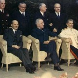 Clement_Attlee,_Harry_S._Truman,_Joseph_Stalin_and_their_principal_advisors_-_Potsdam_Conference_1945